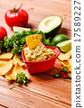 Guacamole with avocado, lime, tomato, and cilantro 17589227