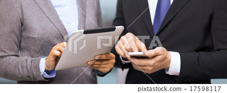 two businesspeople with smartphone and tablet pc 17598117