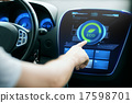 male hand setting car eco system mode on screen 17598701