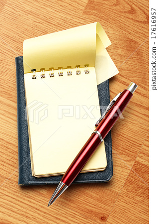 Yellow blank notepad with pen 17616957