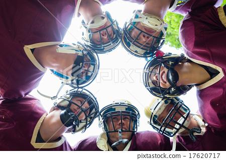 Stock Photo: American Football Team having huddle in match