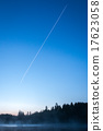 Contrails in the blue sky before sunrise 17623058