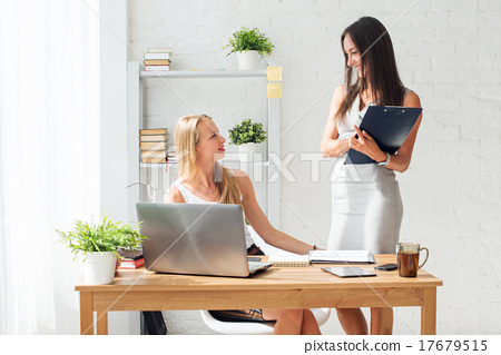 Stock Photo: Two young woman colleague at office working