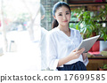 woman surfing the net in coffee shop 17699585