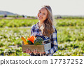Young woman holding wooden crate with vegetables 17737252