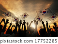 Silhouettes of People Holding Flag of South Korea 17752285