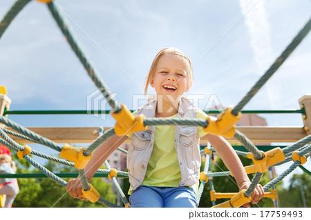 Stock Photo: happy little girl climbing on children playground