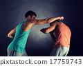 young men wrestling 17759743