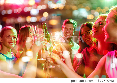 Stock Photo: smiling friends with wine glasses and beer in club