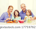 happy family with two kids making dinner at home 17759762