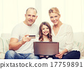 parents and girl with laptop and credit card 17759891