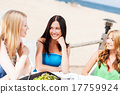 girls in cafe on the beach 17759924