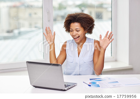 Stock Photo: happy african woman with laptop at office