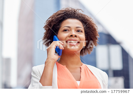 Stock Photo: happy african businesswoman calling on smartphone