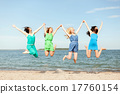 smiling girls jumping on the beach 17760154