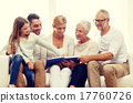 happy family with book or photo album at home 17760726