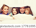 happy family with two kids under blanket at home 17761095