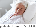 senior woman patient lying in bed at hospital ward 17761834