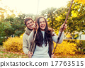 smiling couple hugging in autumn park 17763515