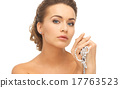 woman with pearl earrings and necklace 17763523