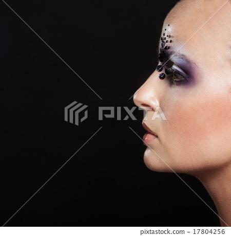 Portrait of bald girl with creative makeup  17804256