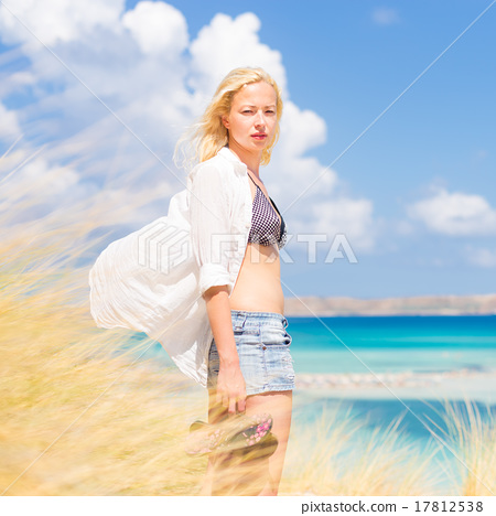 Free Happy Woman Enjoying Sun on Vacations. 17812538