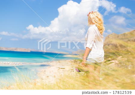 Free Happy Woman Enjoying Sun on Vacations. 17812539