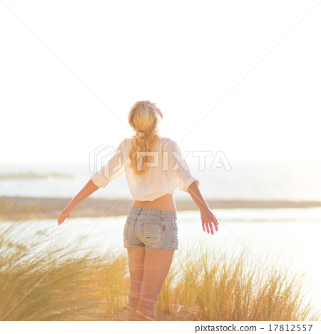 Free Happy Woman Enjoying Sun on Vacations. 17812557