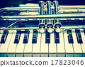 Trumpet on keyboard background 17823046