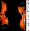 Closeup Violin orchestra musical instruments on black background 17823640