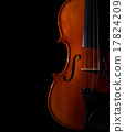 Closeup Violin orchestra musical instruments on black background 17824209