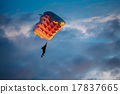Skydiver On Colorful Parachute In Sky 17837665
