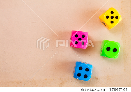 Dice on the cardboard background 17847191