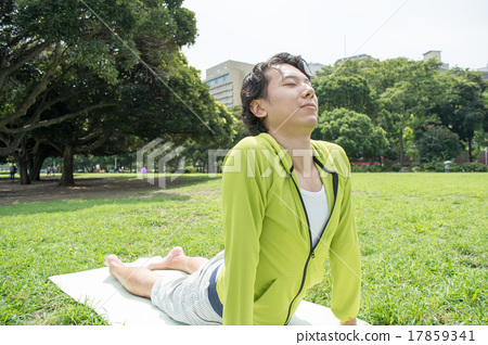 Young Asian fitness man doing yoga outside 17859341