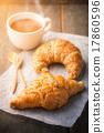 Croissant on wood table 17860596