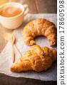 Croissant on wood table 17860598