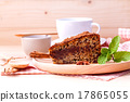 Homemade dark chocolate cake with cup of coffee . 17865055
