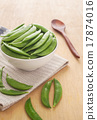 Fresh peas in white bowl on wooden 17874016