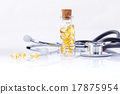 Fish liver oil capsules in bottle with stethoscope 17875954