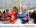 Adorable little girl enjoying a carousel ride 17890061
