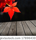 autumn theme and empty wooden deck table 17896430