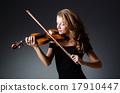 Attractive woman with cello in studio 17910447
