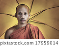 Buddhist monk holding umbrella Ceremony Concept 17959014
