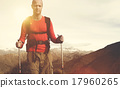Extreme Hiking Across Rugged Mountains Concept 17960265