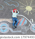 Little child in helmet with motorcycle picture drawing with colo 17974493