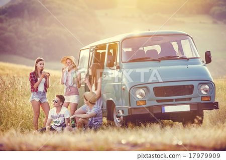 Stock Photo: Young hipster friends on road trip
