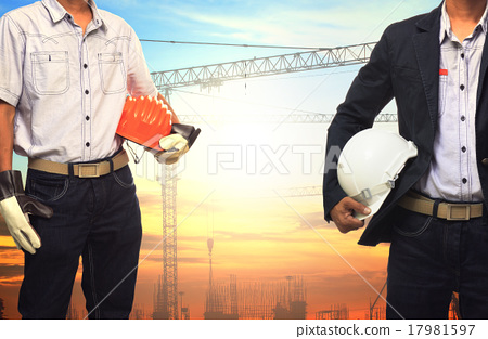 Stock Photo: two engineer man working with white safety helmet