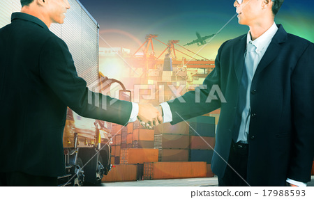 Stock Photo: two business man shaking hand transport industry