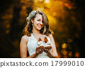 bride holding wedding shoes 17999010