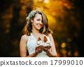 bride holding wedding shoes 17999010